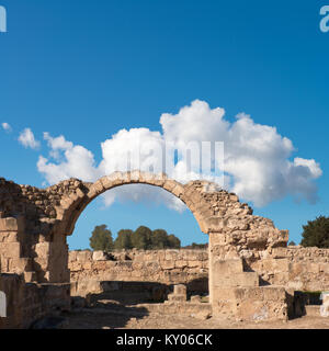 Roman arch in Paphos archaeological park at Kato Pafos in Cyprus, panoramic image, text space - Stock Photo