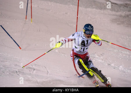 The Austrian World Cup alpine ski racer Benjamin Raich (21) sets pace during the first run of the Men's Slalom at - Stock Photo
