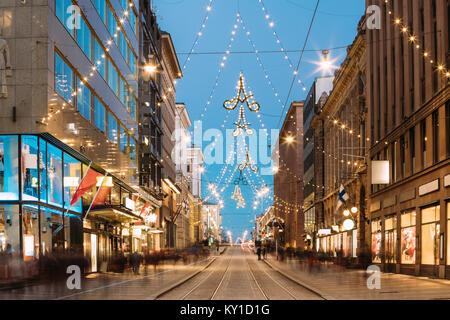 Helsinki, Finland. Night View Of Aleksanterinkatu Street With Railroad In Kluuvi District In Evening Christmas Xmas - Stock Photo