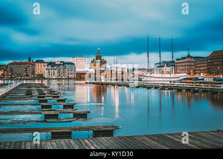 Helsinki, Finland. View Of Evening City And Uspenski Cathedral From Pier. - Stock Photo