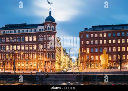 Helsinki, Finland. Crossroad Of Pohjoisranta And Kirkkokatu Street In Evening Or Night Illumination. - Stock Photo
