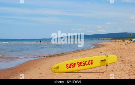 Surf rescue surfboard on Inverness beach, Cape Breton Island, Nova Scoatia, Canada. West coast of Cape Breton Island - Stock Photo