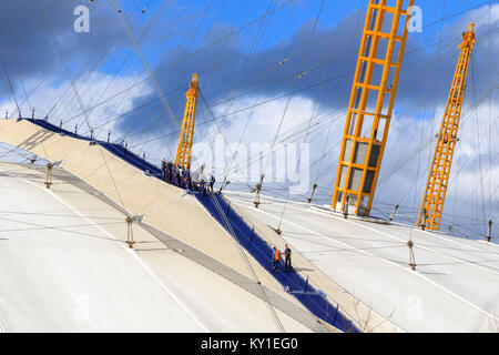 London, UK - June 25, 2017 - A group of people climbing the top of O2 dome in North Greenwich - Stock Photo