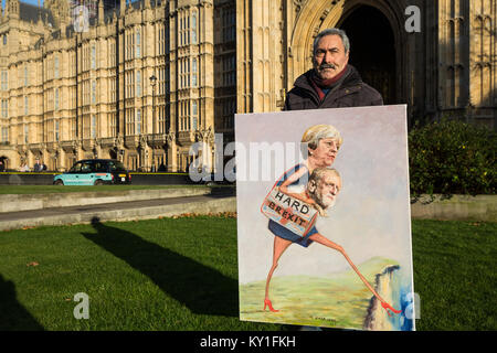 London, UK. 10th Jan, 2018. Satirical artist Kaya Mar stands outside Parliament with a new satirical artwork on - Stock Photo
