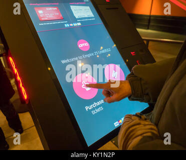 A customer uses a ticket-buying kiosk in the AMC 25 Theatre in Times Square in New York on Saturday, December 30, - Stock Photo