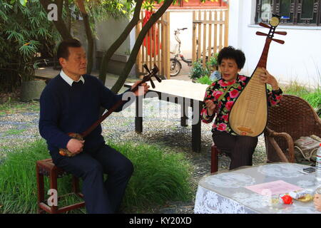 Chinese Traditional Music perform by an elderly couple in the tea Garden. Travel in Suzhou City, China in 2009 ,April - Stock Photo
