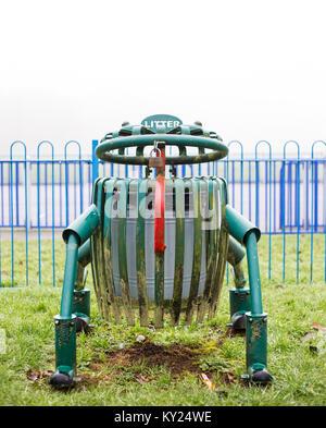 Council property frog-shaped litter bin in public park, Kidderminster, UK. Rubbish weather, but funny metal bin - Stock Photo