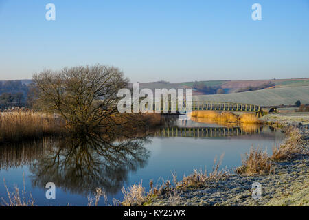 River reflections on a cold morning in Amberley - Stock Photo