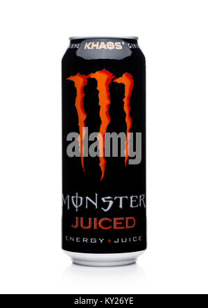 LONDON, UK - JANUARY 02, 2018: A can of Monster Energy Drink juiced on white background. Introduced in 2002 Monster - Stock Photo