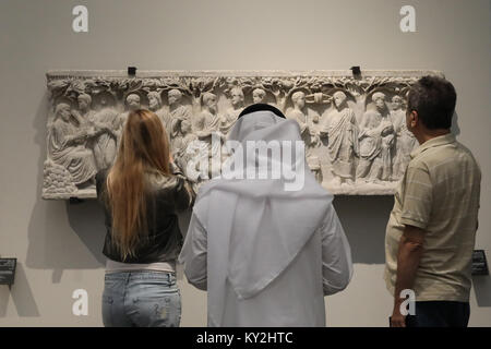 Abu Dhabi, UAE. 12th January, 2018. Visitors examine the displays in the Louvre Abu Dhabi in the UAE capital on - Stock Photo