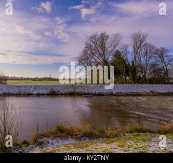 Color outdoor snowy landscpae panoramic photography of a morning at a river with blue sky,light clouds, sunlight - Stock Photo
