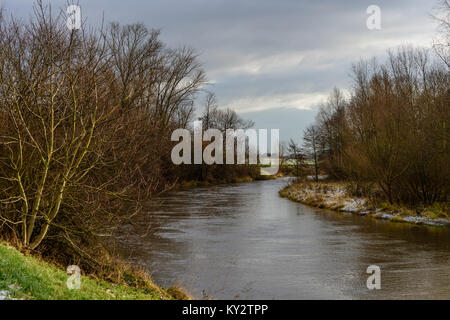 Color outdoor snowy landscpae panoramic photography of a morning over a river with blue sky, clouds,a view over - Stock Photo