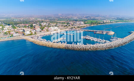 Aerial bird's eye view of Zygi fishing village port, Larnaca, Cyprus. The fish boats moored in the harbour with - Stock Photo