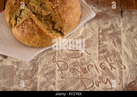 Traditional Irish Soda Bread Made For St. Patrick's Day Served On Floured Wooden Table - Stock Photo