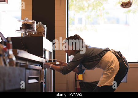 Beautiful waitress working at counter - Stock Photo