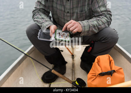 Man with bait box in his hands - Stock Photo