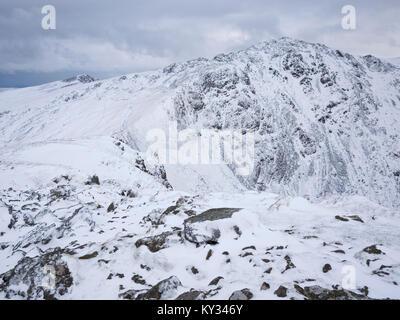 View to Penygadair, the summit of Cadair Idris, from Craig Cau under winter conditions. Snowdonia National Park, - Stock Photo