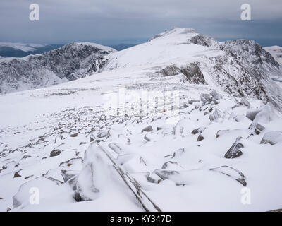 View to Penygadair, the summit of Cadair Idris, from Mynydd Moel under winter conditions. Snowdonia National Park, - Stock Photo