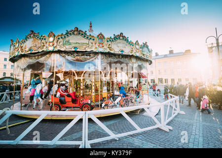 Helsinki, Finland - December 11, 2016: Christmas Holiday Carousel In Senate Square In Sunny Winter Day - Stock Photo