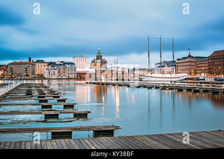 Helsinki, Finland - December 6, 2016: View Of Evening City And Uspenski Cathedral From Pier. - Stock Photo