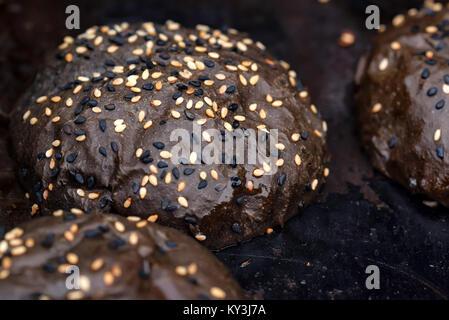 Close up of sesame rye bread bun - Stock Photo