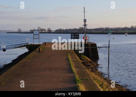 Harbour Wall Jetty Point, Exeter Ship Canal on the Exe Estuary at Turf Lock Hotel. Powderham Estate in Distance. - Stock Photo