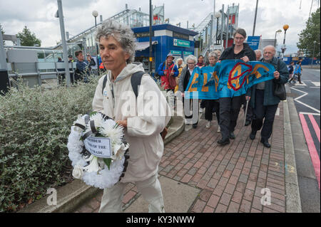 The East London Against Arms Fairs procession around the Royal Victoria Dock in opposition to the DSEi Arms Fair - Stock Photo