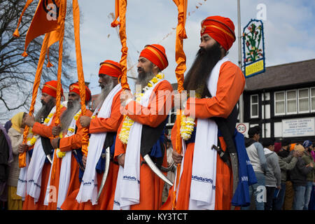 People taking part in a bi-annual Sikh religious procession through the streets of Leicester, England. According - Stock Photo