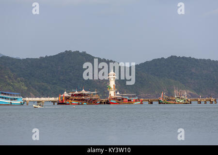 Lighthouse on a pier on Koh Chang Island in Thailand - Stock Photo