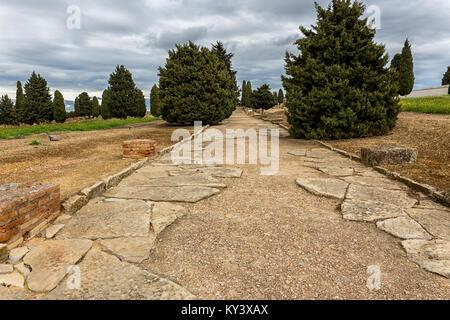 Roman road in the ruins of Italica. Located in Santiponce near Sevilla. Spain. - Stock Photo