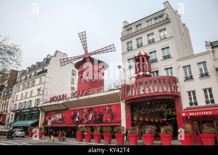 PARIS, FRANCE - DECEMBER 19, 2017: Moulin Rouge cabaret taken during a cloudy afternoon in the red light district - Stock Photo
