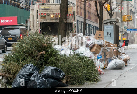 Bags of trash await pick-up in New York on Thursday, January 11, 2017. As the snow melts from our recent storm and - Stock Photo