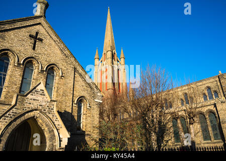 Amongst rows of red and white brick terrace houses is William Rangers 1840 Victorian Gothic church of St John the - Stock Photo