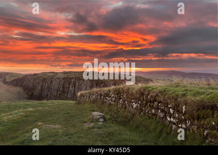 Hadrian's Wall: the view to the east at dawn, looking from Steel Rigg over a section of the Wall and on to Peel - Stock Photo