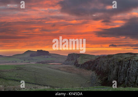 Hadrian's Wall: the view to the east at dawn, looking from Steel Rigg towards Peel Crags, Highshield Crags, Crag - Stock Photo
