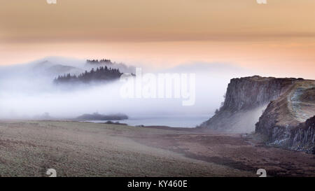 Hadrian's Wall: the view from Steel Rigg on a misty winter's morning at dawn, looking east towards Crag Lough, Peel, - Stock Photo