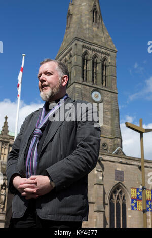 The Reverend David Monteith, dean of Leicester, pictured outside the city's cathedral. The local football club, - Stock Photo