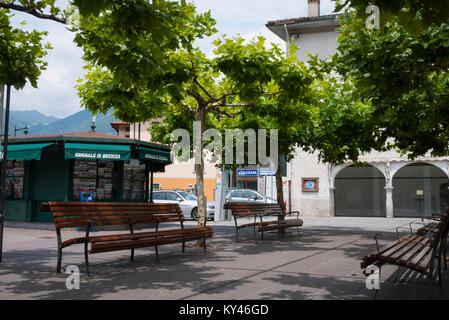 Benches in Pisogne  town square next to Lake Iseo in Italy - Stock Photo