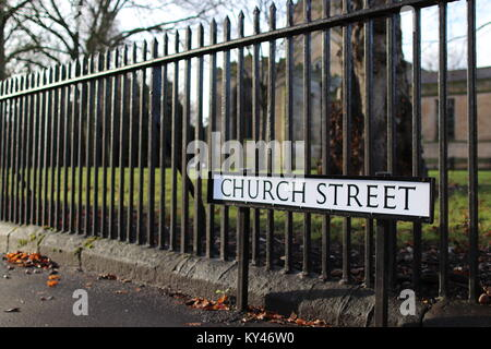Church Street Road Sign with church behind - Stock Photo