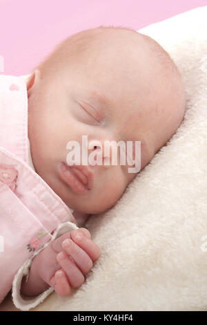 10 week old baby girl, small premature baby - Stock Photo