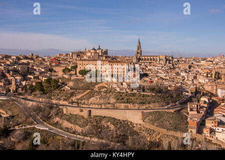 Panoramic view of the city walls of Toledo, medieval buildings and Saint Mary's Cathedral. Spain.