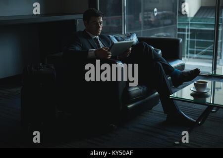 Businessman using digital tablet - Stock Photo