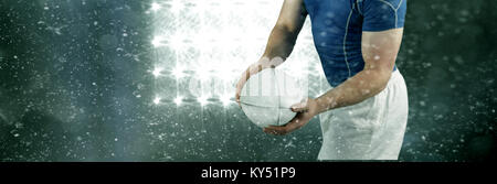 Composite image of rugby player about to throw the rugby ball - Stock Photo