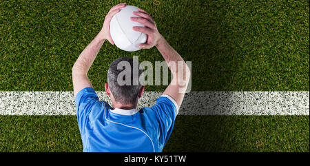 Composite image of rugby player about to throw a rugby ball - Stock Photo