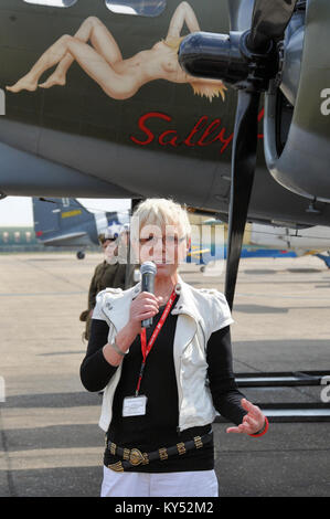 Elly Sallingboe speaking at an airshow about the Boeing B-17 Flying Fortress Sally B bomber plane that she operates - Stock Photo