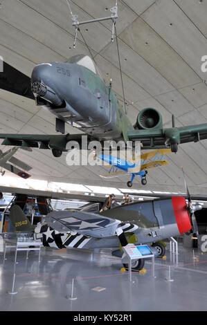 Modern Fairchild Republic A-10 Thunderbolt II hanging over a second world war Republic P-47 Thunderbolt showing - Stock Photo