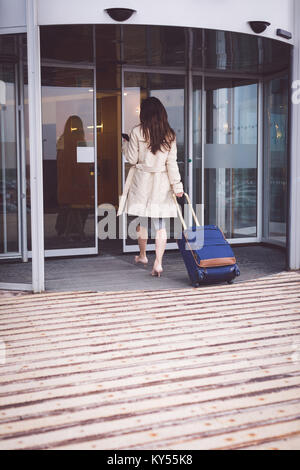 Businesswoman arriving in hotel - Stock Photo