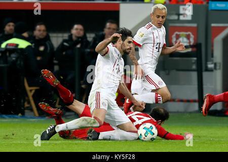 Leverkusen, Germany. 12th Jan, 2018. Javi Martinez (L) of Bayern Munich vies with Admir Mehmedi of Leverkusen during - Stock Photo