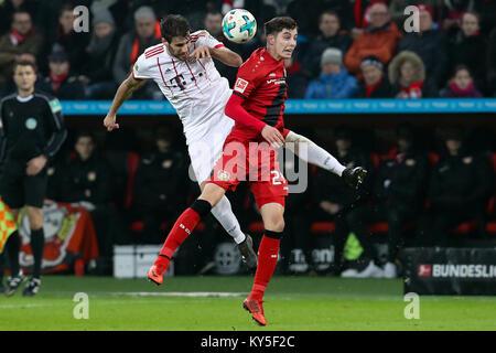 Leverkusen, Germany. 12th Jan, 2018. Javi Martinez (L) of Bayern Munich vies with Kai Havertz of Leverkusen during - Stock Photo