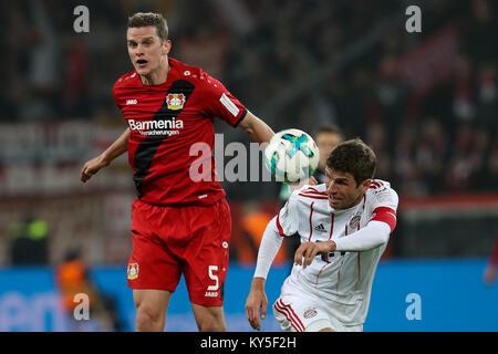Leverkusen, Germany. 12th Jan, 2018. Thomas Mueller (R) of Bayern Munich vies with Sven Bender of Leverkusen during - Stock Photo